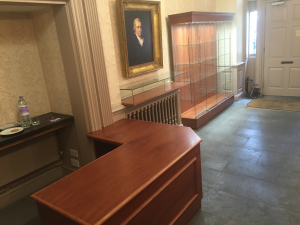 Wooden glass display cases and reception desk