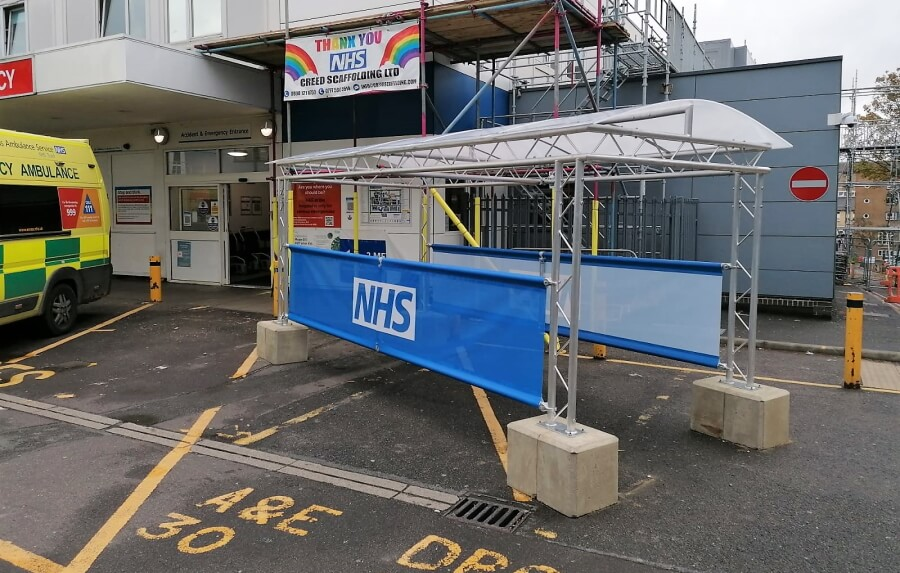 Covered walkway canopy at NHS hospital